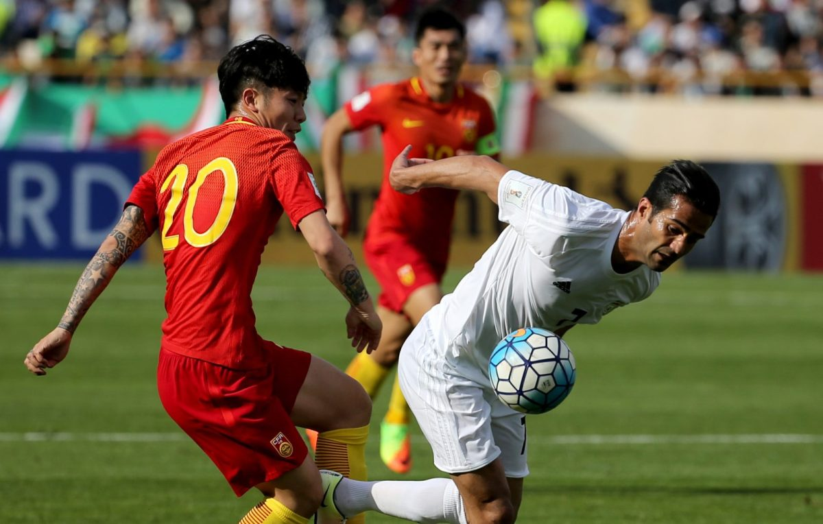 Iran's Masoud Shojaei (right) fights for the ball with China's Zhag Xizhe (left) during a 2018 World Cup qualifying football match in Tehran on March 28, 2017. China are ranked a lowly 60th in the world by Fifa. Photo: AFP / Atta Kenare