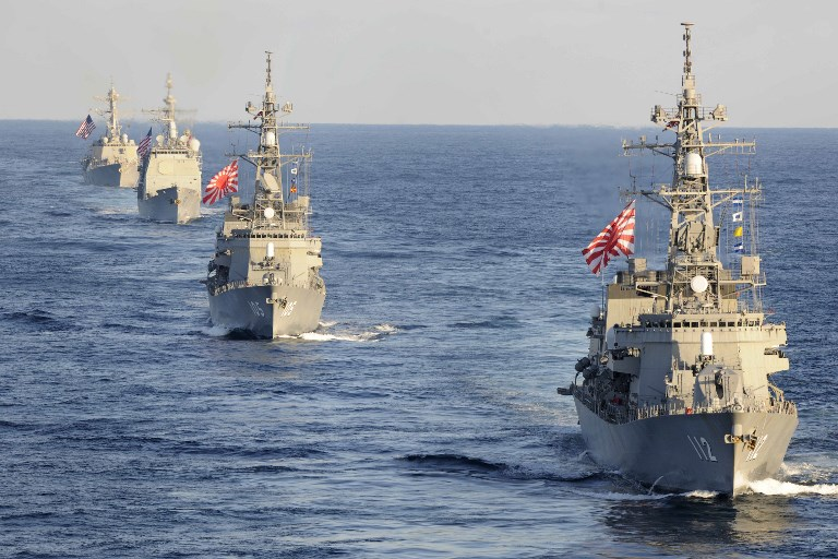 Japanese Maritime Self-Defense Force destroyers followed by a US cruiser and destroyer conducting joint operations in November. Photo: US Navy via AFP