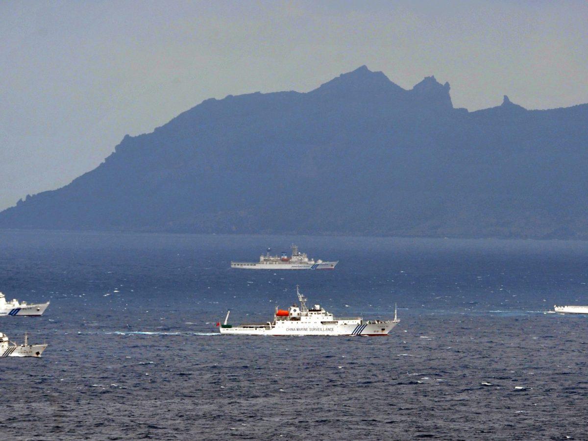 Chinese fishery surveillance ships (center and  below left) enter the Japanese territorial waters near Uoturijima (background),  one of the main island of the disputed Senkaku Islands. Photo: AFP via The Yomiuri Shimbun