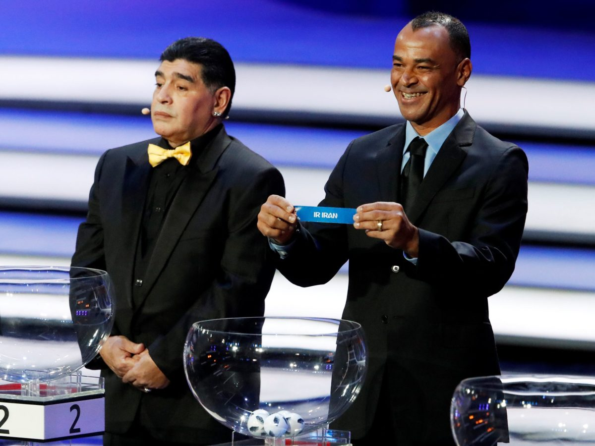 Cafu pulls 'Iran' out of the bowl and Diego Maradona looks uncomfortable as the draw is made for the 2018 FIFA World Cup at the Kremlin Palace in Moscow on December 1. Photo: Reuters / Sergei Karpukhin