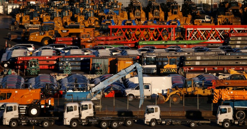 Newly manufactured vehicles await export at a port in Yokohama, Japan, January 16, 2017. Photo: Reuters / Toru Hanai