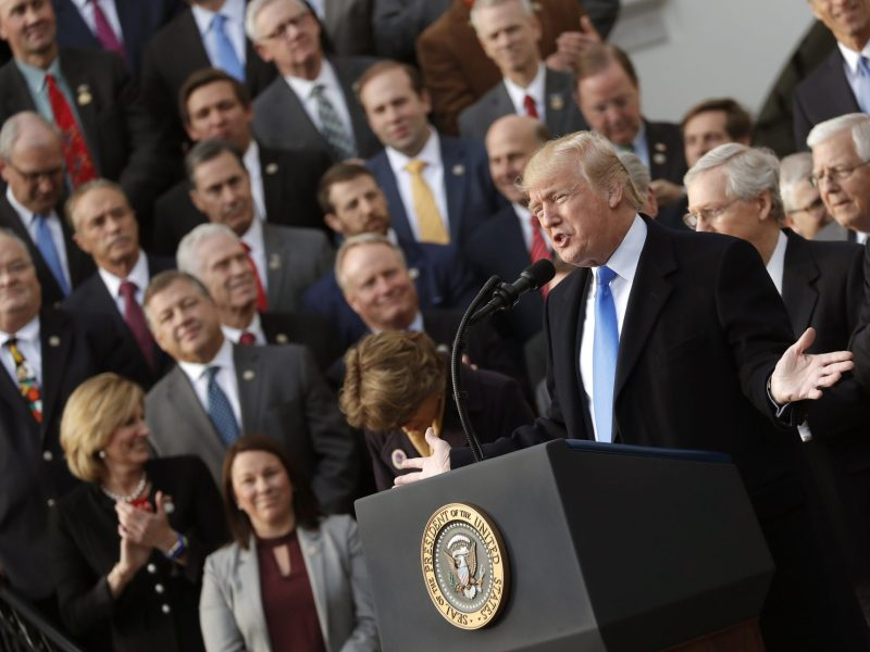 US President Donald Trump celebrates with Congressional Republicans after Congress passed sweeping tax overhaul legislation. Photo: Reuters / Carlos Barria