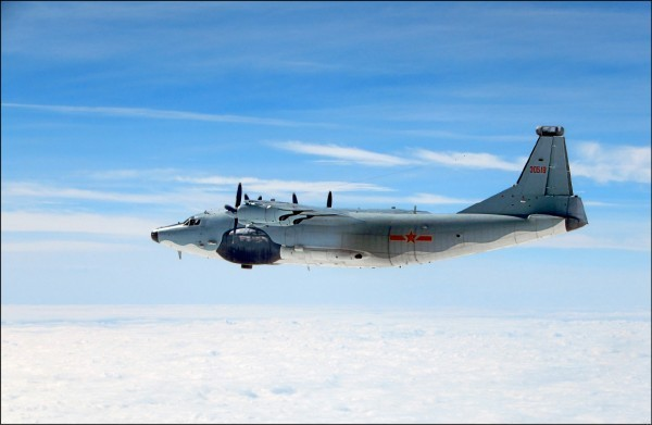 A photo dispatched by Taiwan's Defense Ministry shows a Chinese Y-8 plane above the Taiwan Strait.