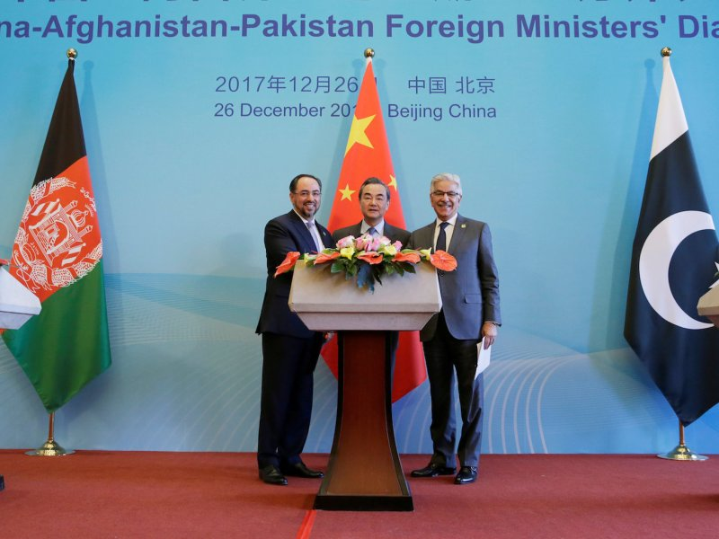 Afghanistan Foreign Minister Salahuddin Rabbani, (L) China's Foreign Minister Wang Yi and Pakistan Foreign Minister Khawaja Asif after the first China-Afghanistan-Pakistan Foreign Ministers' Dialogue in Beijing on December 26, 2017. Photo: Reuters/Jason Lee