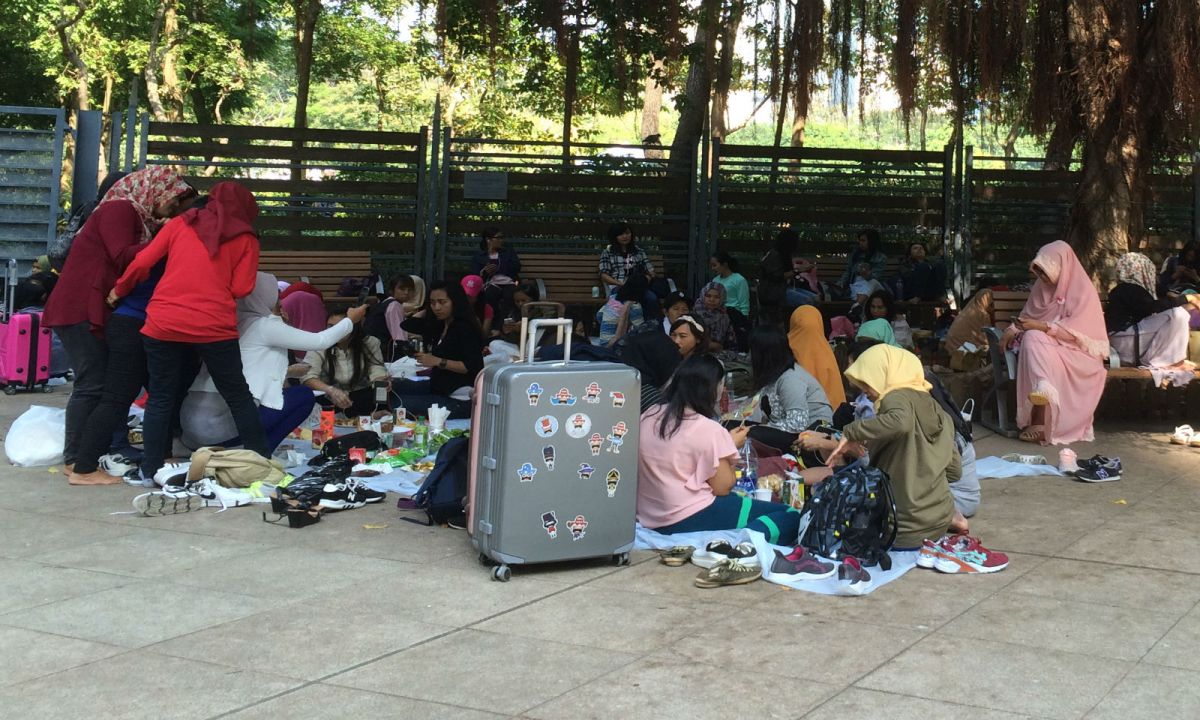 Indonesian domestic workers gather in Victoria Park in Causeway Bay on their day off. Photo: Asia Times