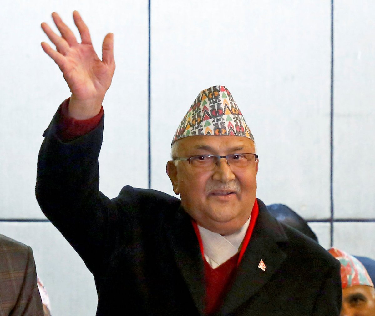 CPN-UML party chairman K P Oli waves to journalists during a news conference in Kathmandu on December 17, 2017. Photo: Reuters / Navesh Chitrakar