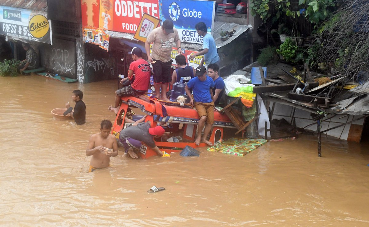 Residents wade through the flooding in Cagayan de Oro city in the Philippines. Photo: Reuters / Froilan Gallardo