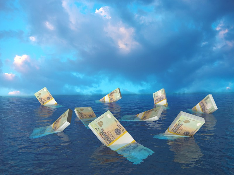 An image of Vietnam's dong currency sinking in water. Image: iStock/Getty Images
