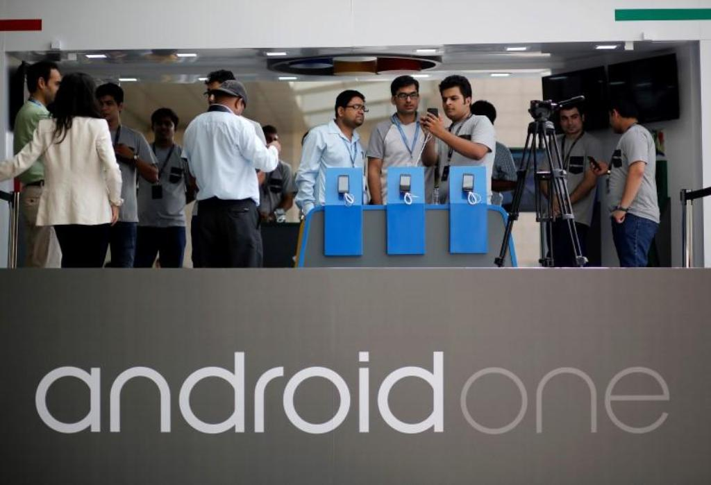 Visitors look at Android One based mobiles after its launch in New Delhi in 2014: Reuters