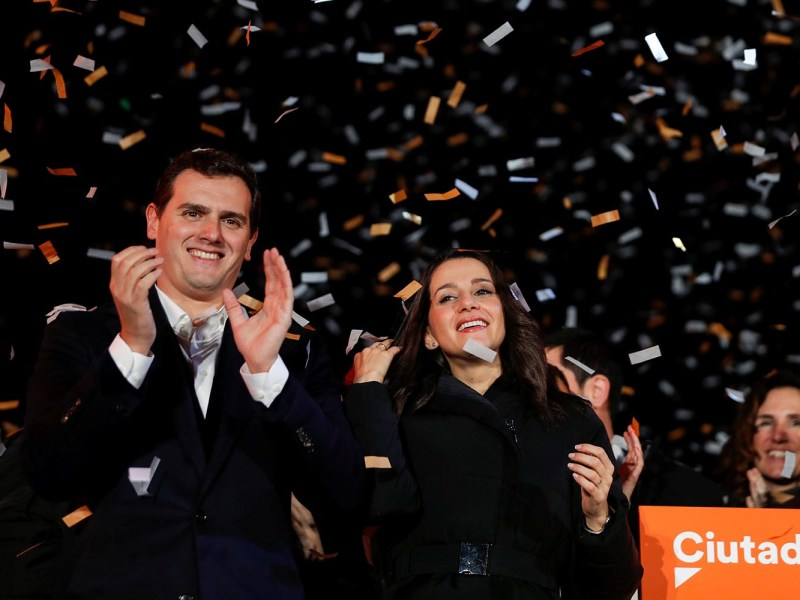 Catalan Ciudadanos leader Ines Arrimadas (C) smiles next to Ciudadanos national leader Albert Rivera at a Ciudadanos rally after results were announced in Catalonia's regional elections in Barcelona, Spain on  December 21, 2017. Photo: Reuters / Eric Gaillard