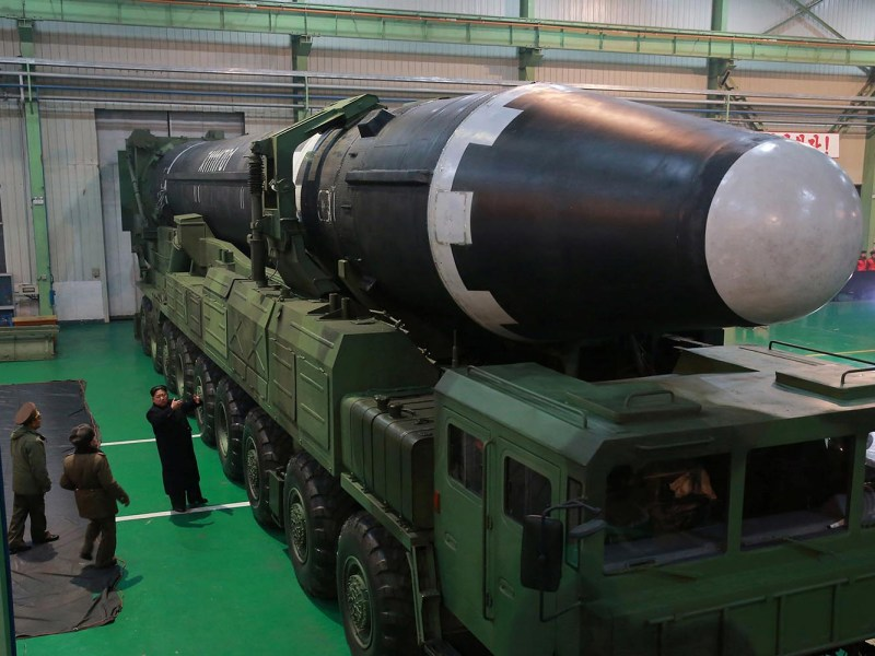North Korean leader Kim Jong Un stands next to a Hwasong-15 ballistic missile. Photo: Reuters / KCNA