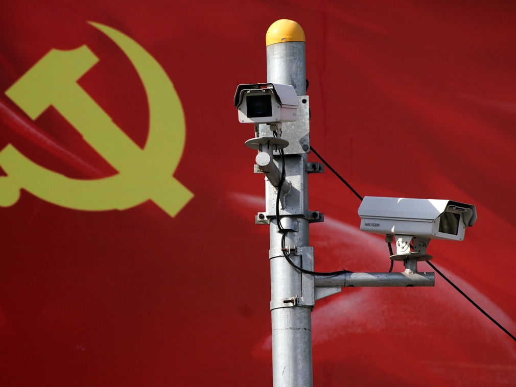 CCTV cameras are seen in front of a Chinese Communist Party flag. Photo: Reuters