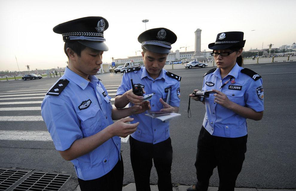 Police constables brief each other when patrolling in Beijing's Tiananmen Square. Photo: Xinhua