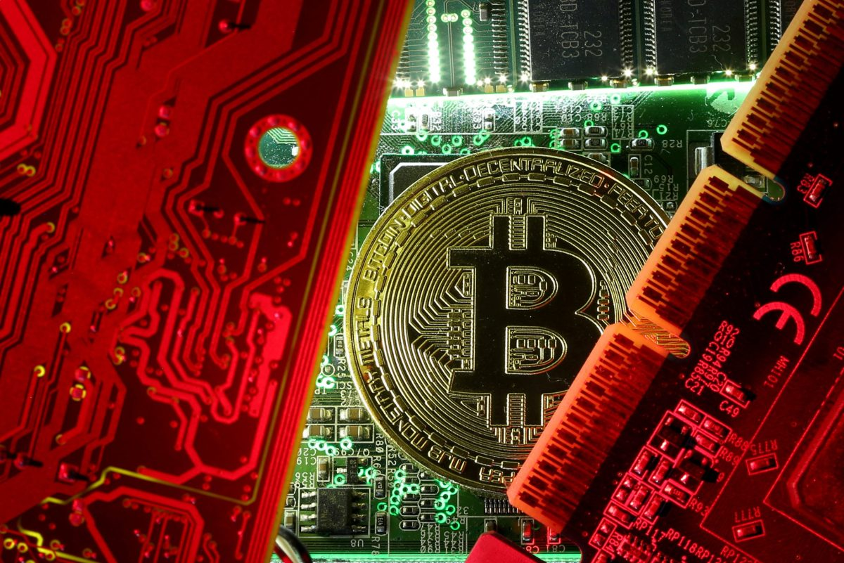 Crypto-currency logos. Photo: Reuters/Dado Ruvic