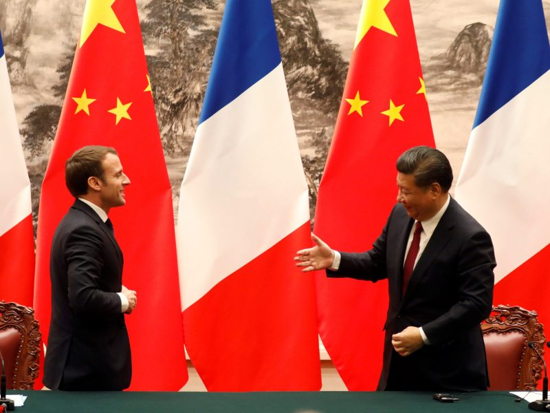 French President Emmanuel Macron and Chinese President Xi Jinping leave after a press conference in Beijing. Photo: Reuters / Charles Platiau