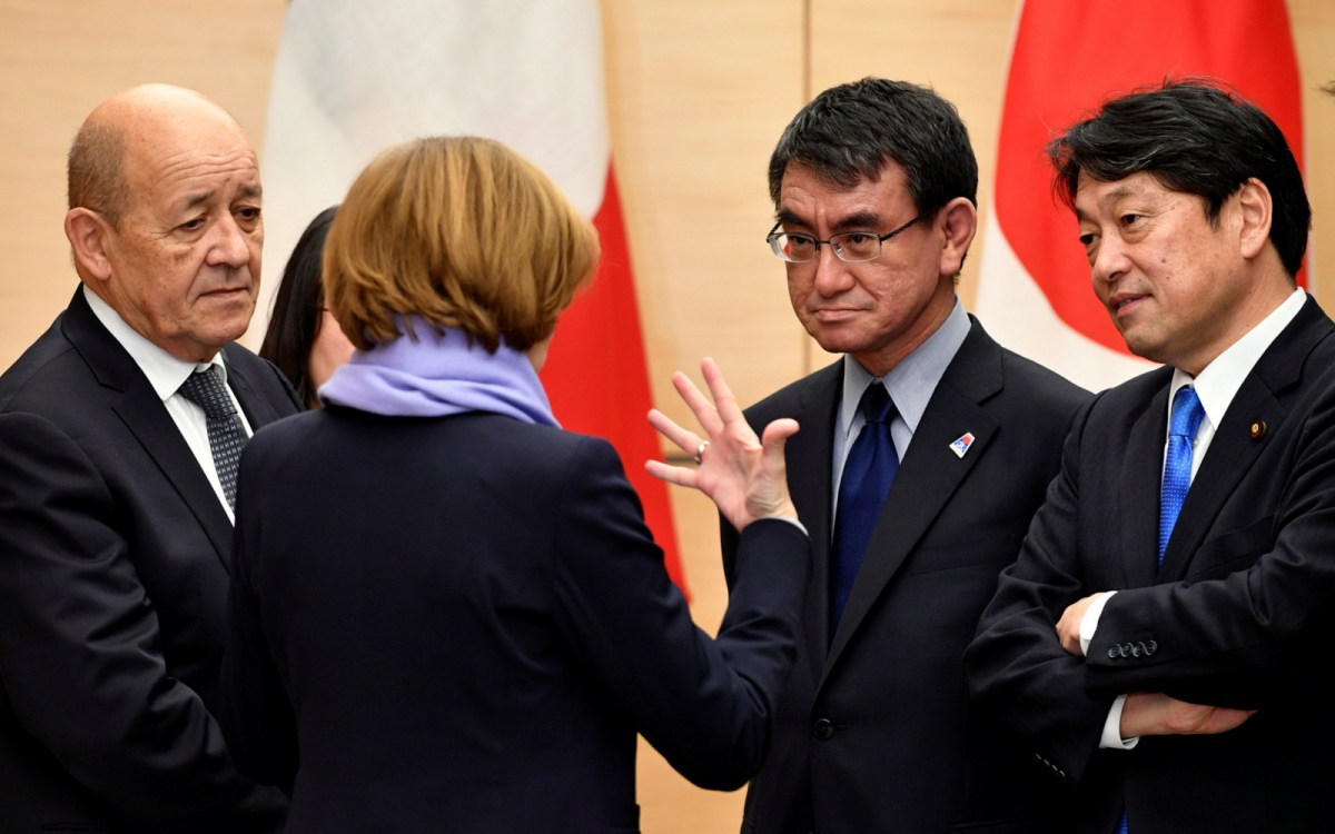 French Foreign Minister Jean-Yves Le Drian (L) listens to Minister of the Armed Forces Florence Parly (2-L) with Japanese Foreign Minister Taro Kono (2-R) and Defense Minister Itsunori Onodera (R) in Tokyo. Photo: Reuters/Frank Robichon