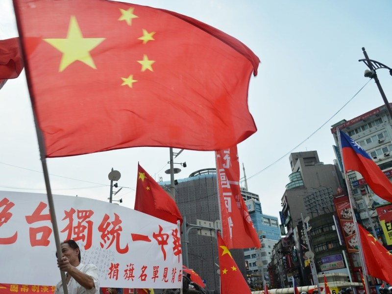 A Chinese flag is seen during a pro-unification rally in Taipei. A Republic of China (Taiwan) flag is seen on the right. Photo: Central News Agency