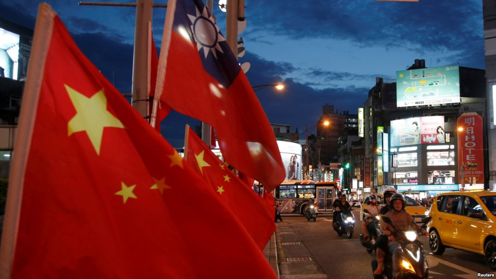 Chinese national flags and the Republic of China (Taiwan) flags are seen in Taipei. Photo: Reuters