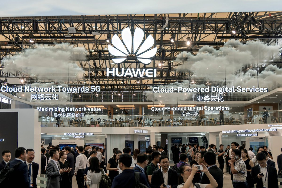 Visitors are seen at a Huawei stand during the 2017 Mobile World Congress. Photo: Reuters