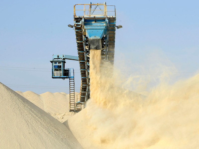 Untreated phosphate dropped at the end of a conveyor belt at the Marca factory of the National Moroccan phosphates company (OCP public), near Laayoune, the capital of Moroccan-controlled Western Sahara in a 2013 file photo. Photo: AFP/Fadel Senna