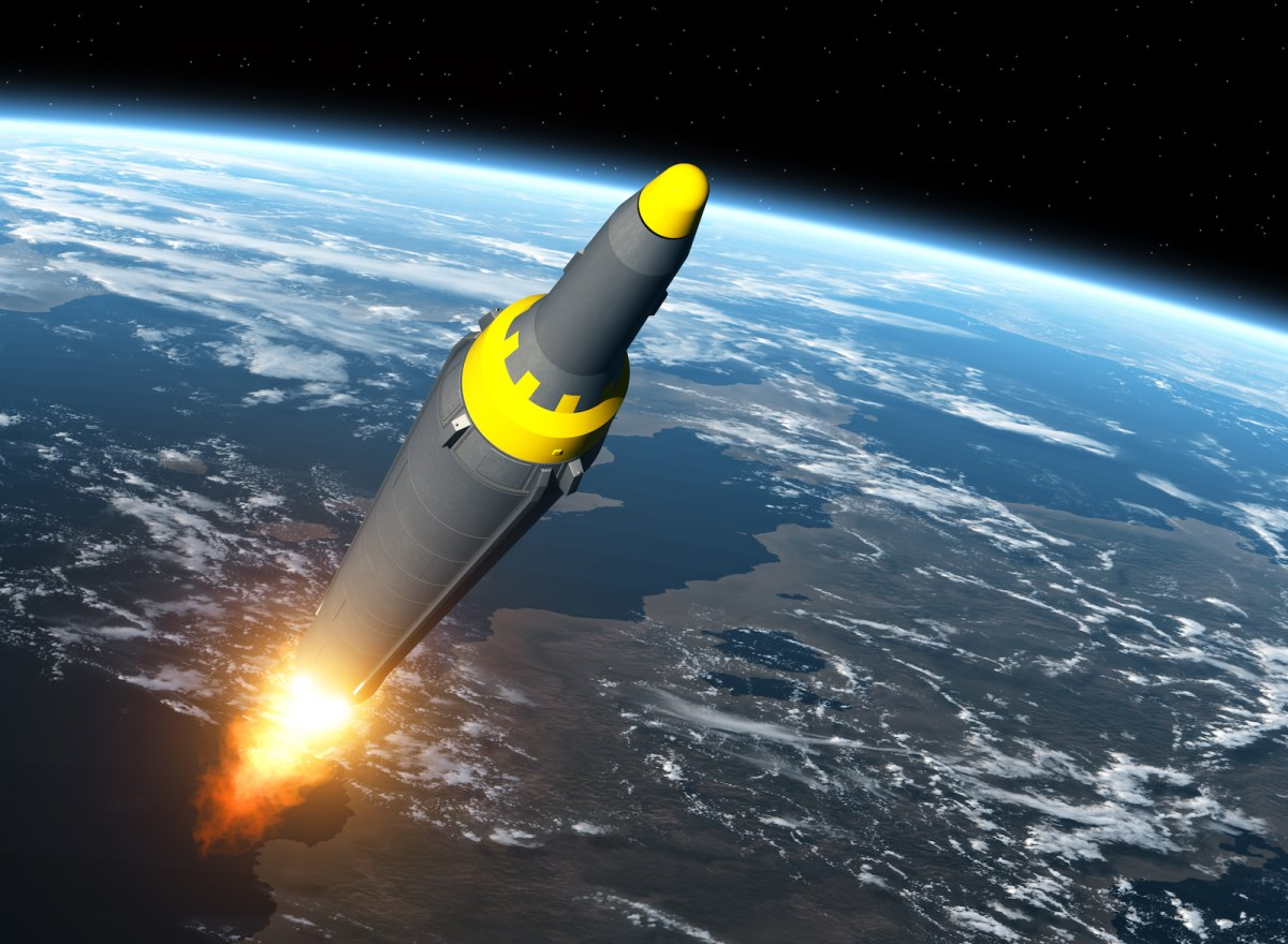 A North Korean ballistic missile blasting through outer space in a three-dimensional Illustration. Image: iStock/Getty Images