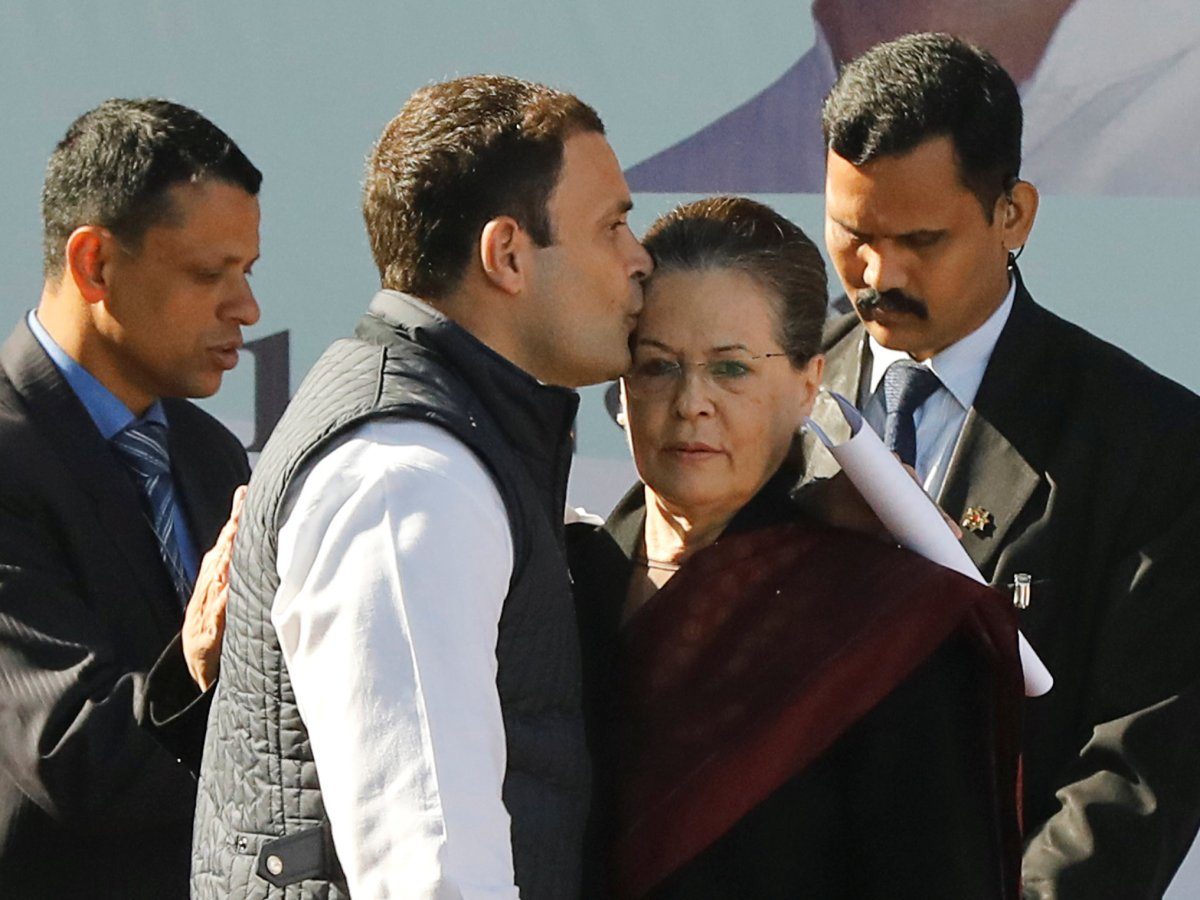 Rahul Gandhi, newly elected president of India's main opposition Congress party, kisses the forehead of his mother and leader of the party Sonia Gandhi after taking charge as the president during a ceremony at the party's headquarters in New Delhi, India, December 16, 2017. Photo: REUTERS/Altaf Hussain