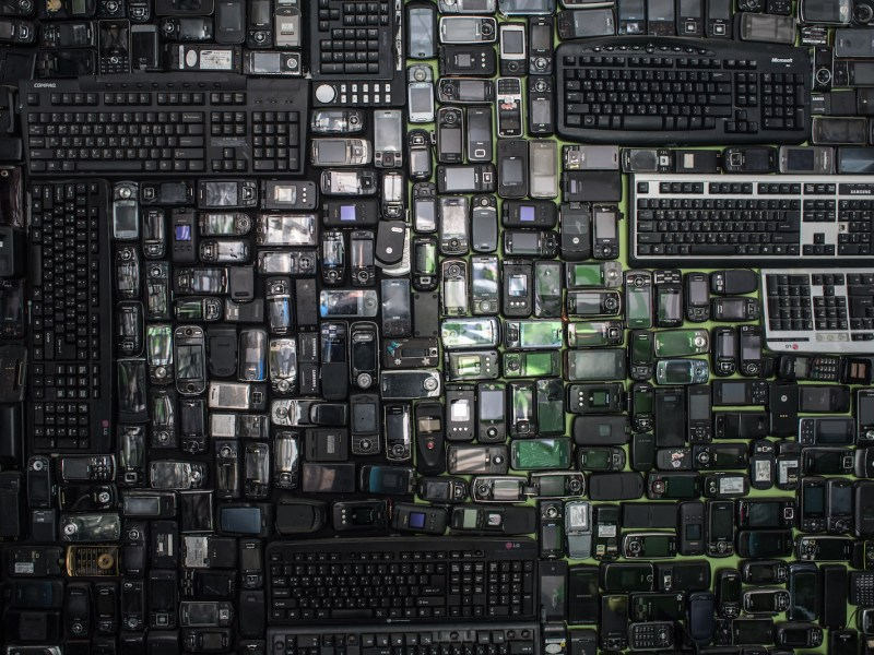 Discarded mobile phones and computer keyboards displayed at the Metropolitan Electronics Recycling Center in Yongin, south of Seoul. Photo: AFP/Ed Jones