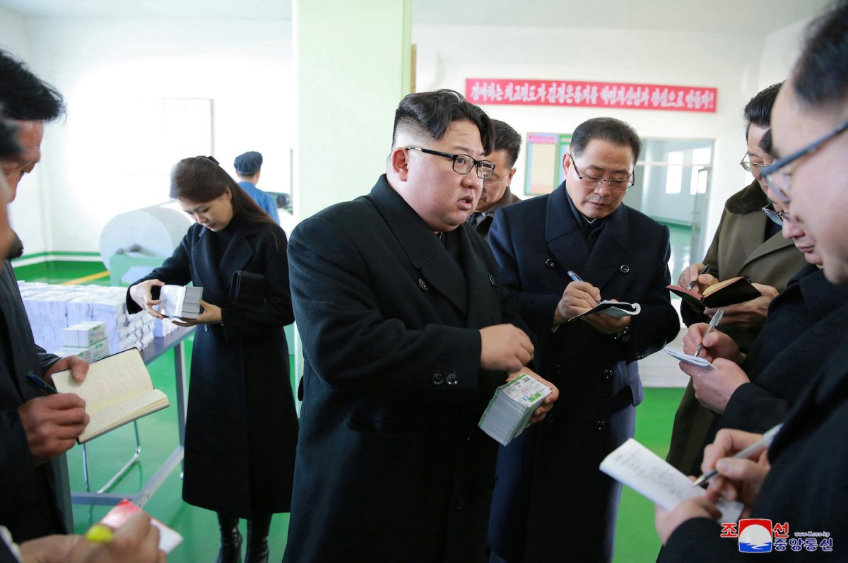 North Korean leader Kim Jong Un, accompanied by his wife Ri Sol Ju, gives tours the Pyongyang Pharmaceutical Factory, in this undated pic released by Korean Central News Agency in Pyongyang on January 25. Photo: KCNA / via Reuters