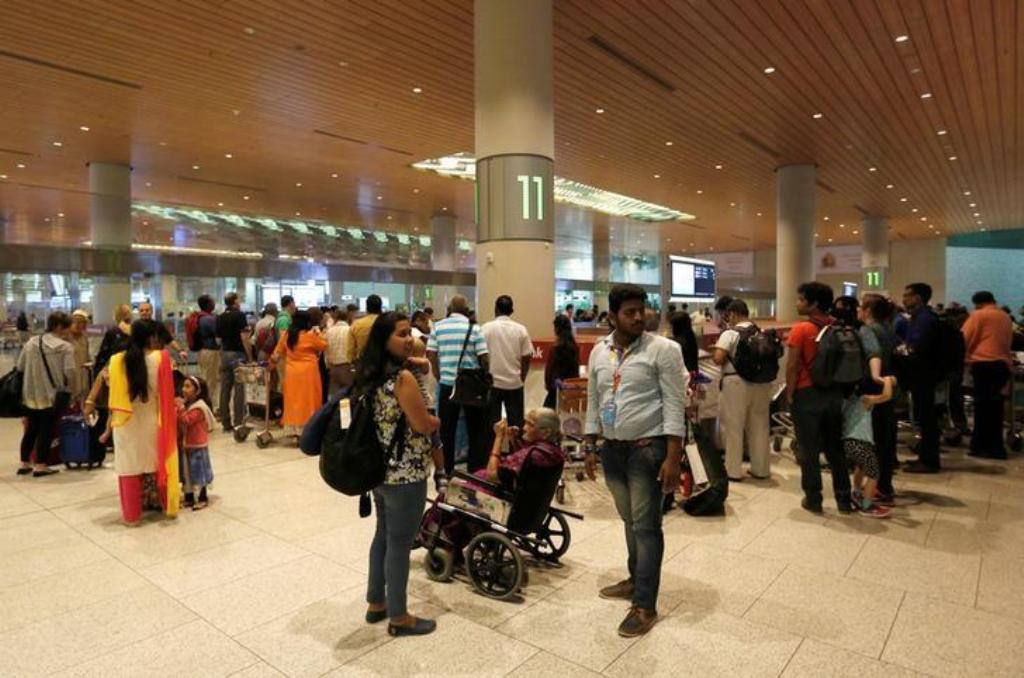Passengers are seen at Chhatrapati Shivaji International Airport in Mumbai. Photo: Reuters