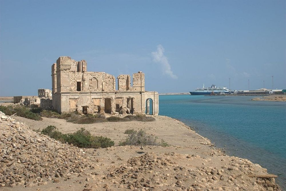 Ruins on Suakin Island by the Red Sea with a vessel in the distance. A revamp of the ancient port is part of a $650m deal Erdogan signed with al-Bashir late last month. Photo: Wikimedia