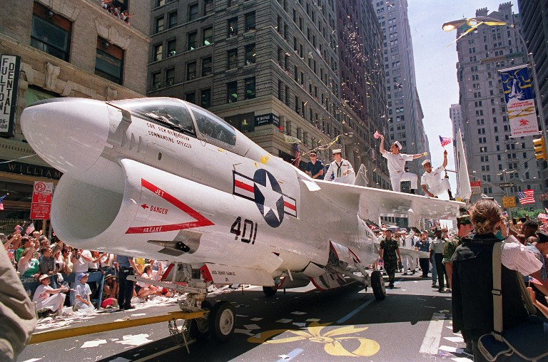 A US Navy A-7 Corsair jet is pulled down Broadway IN New York City as sailors rejoice on the wings during the Operation Welcome Home ticker-tape parade during the June 10, 1991, celebration for returning Gulf War troops. Photo: AFP