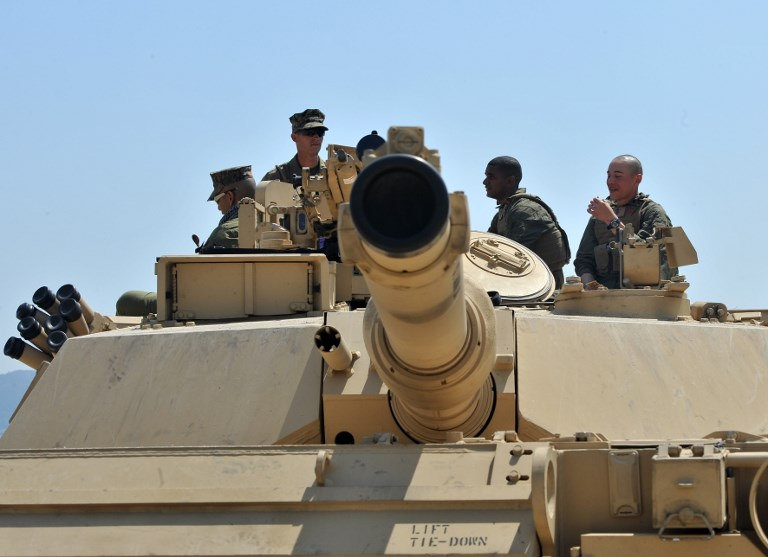 US Marines stand on the top of an M1A1 tank. Photo: AFP