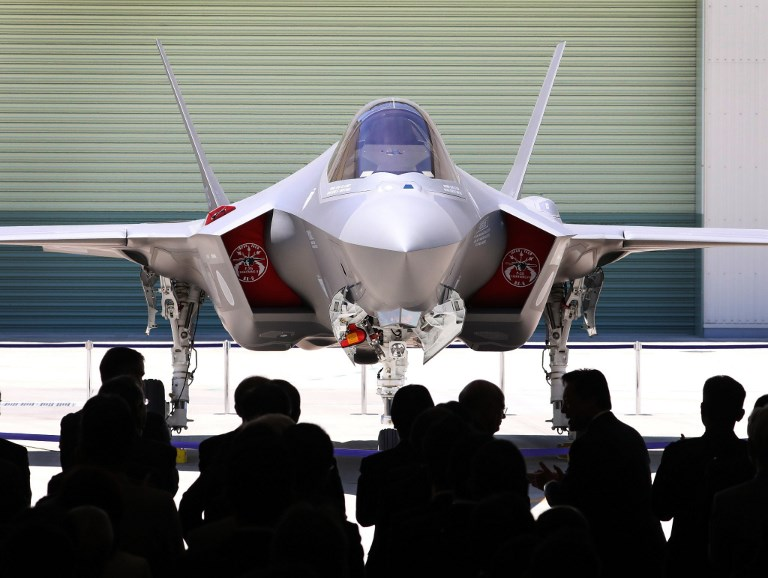 This picture shows the first F-35A stealth fighter assembled in Japan, unveiled at a Mitsubishi Heavy Industries factory in Toyoyama, Aichi Prefecture. Photo: AFP