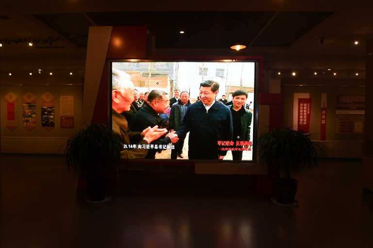 Chinese leader Xi Jinping is seen in a television broadcast visiting villagers. Photo: AFP/Greg Baker