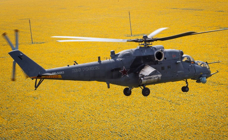 The Russian-built Mi-35M transport/attack helicopter seen here is currently the world's second-fastest military helicopter, behind America's Chinook. Photo: Sputnik via AFP/Vitaliy Timkiv