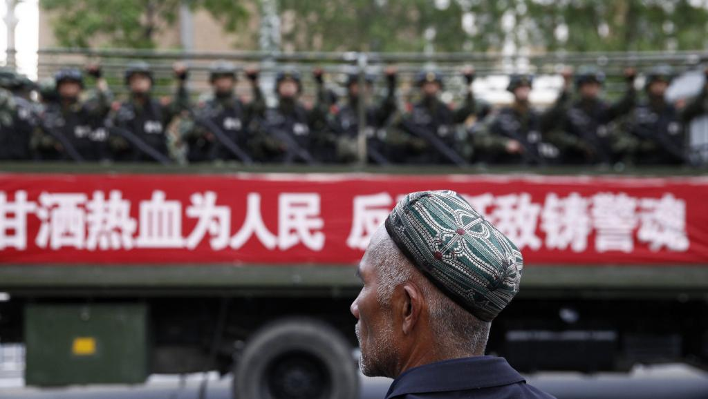 A Uighur man in front of military police during a counter-terrorism drill in Xinjiang. Photo: Reuters