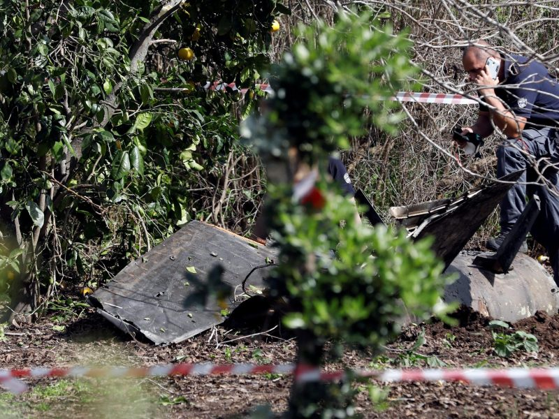 A member of Israeli security personnel inspects fragments of a Syrian anti-aircraft missile found in Alonei Abba, about two miles from where the remains of a crashed F-16 Israeli war plane were found in the village of Alonei Abba, in Israel, on February 10, 2018. Photo: Reuters /  Ronen Zvulun