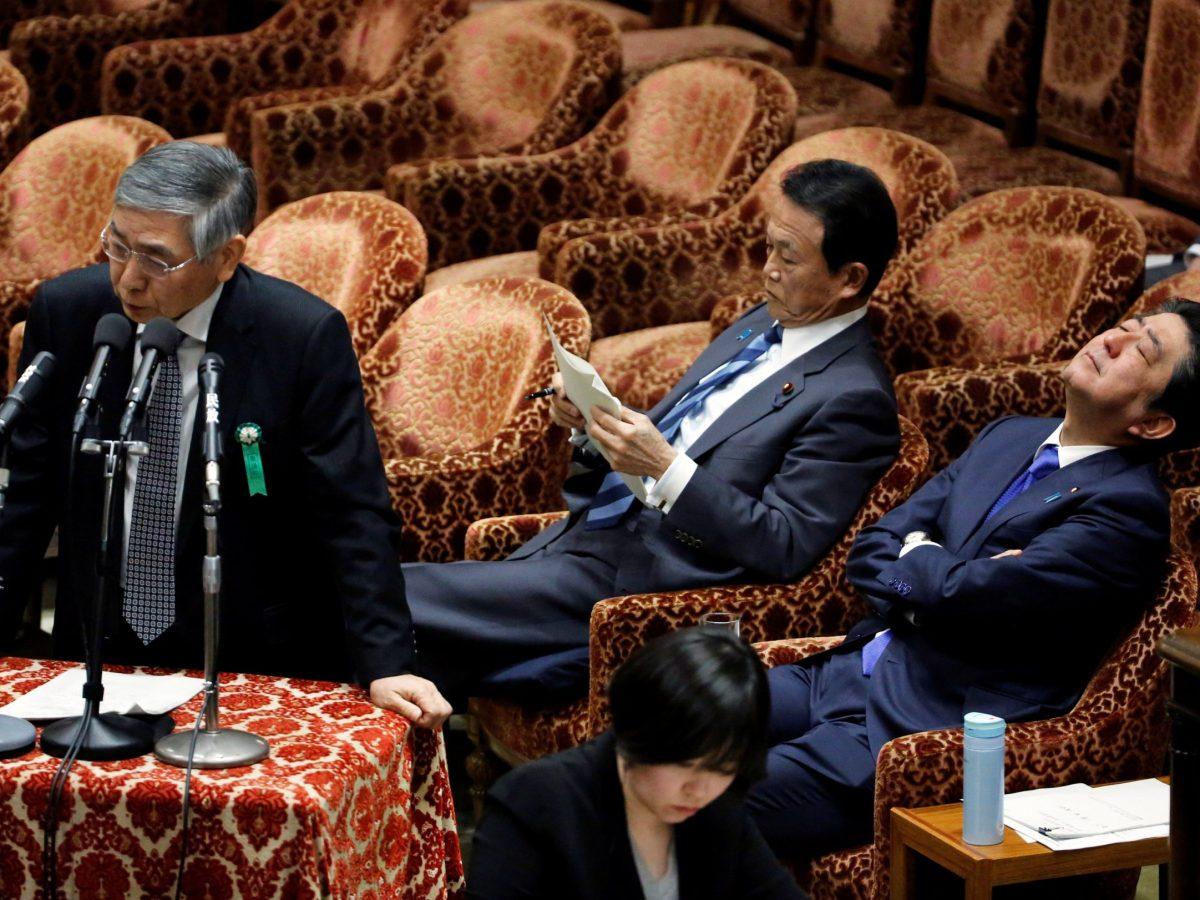 Bank of Japan Governor Haruhiko Kuroda, left, PM Shinzo Abe, right, and Finance Minister Taro Aso attend a budget meet in Tokyo in February. Photo: Reuters / Toru Hanai