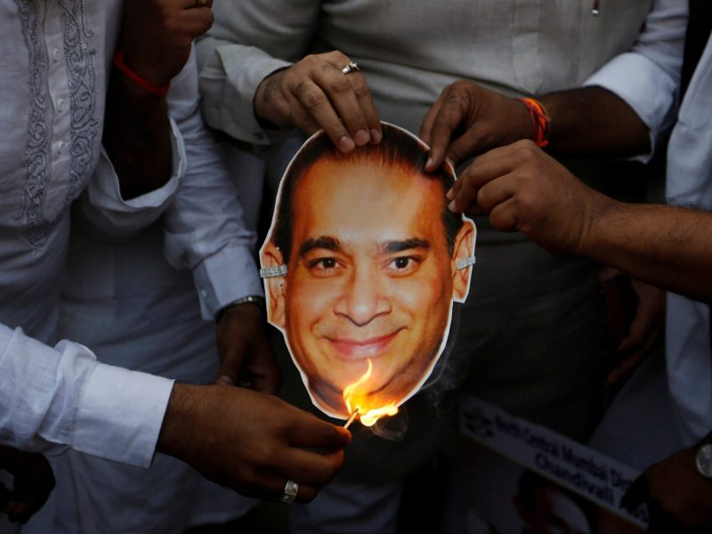 Activists from India's opposition Congress party burn an image of billionaire jeweler Nirav Modi during a protest in Mumbai. Photo: Reuters/ Francis Mascarenhas