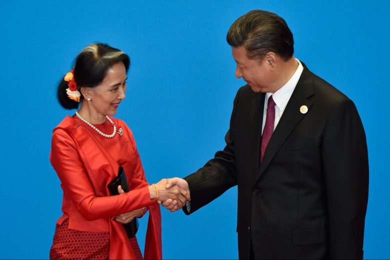 China's President Xi Jinping (R) shakes hands with Myanmar's State Counselor Aung San Suu Kyi as they attend the welcome ceremony at Yanqi Lake during the Belt and Road Forum in Beijing on May 15, 2017. Photo: AFP/Pool