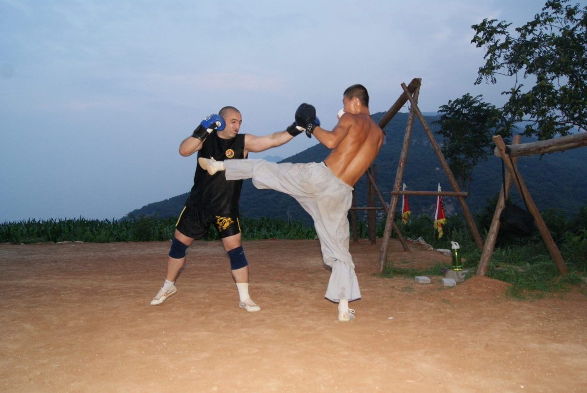 Antonio and his training brother Yilong practise sanda at a Shaolin Temple school. Photo courtesy of Antonio Graceffo