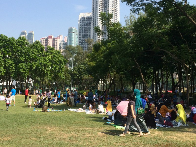 Domestic workers enjoy their weekly day off at Victory Park. Photo: Asia Times