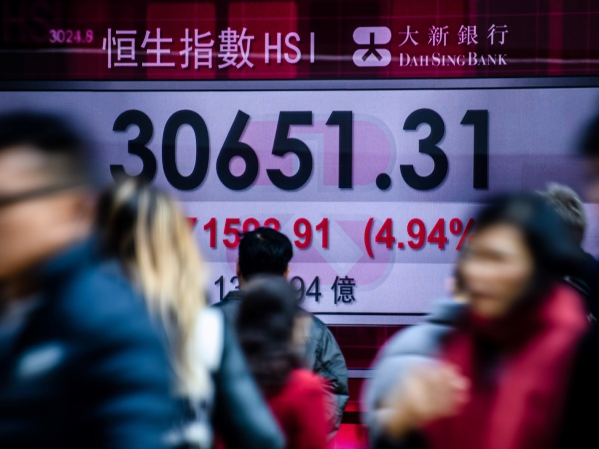 A stock market display board shows the Hang Seng Index down by 4.94%  on Tuesday.  Photo: AFP / Anthony Wallace
