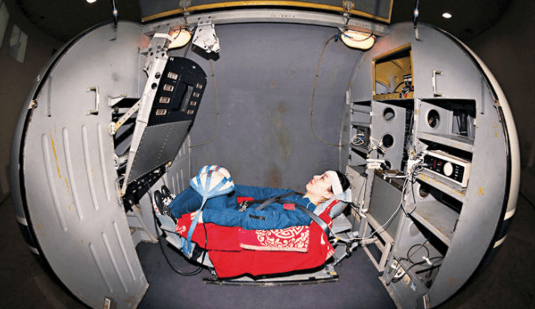 A female taikonaut is seen inside a capsule on a gravity centrifuge during training. Photo: Xinhua