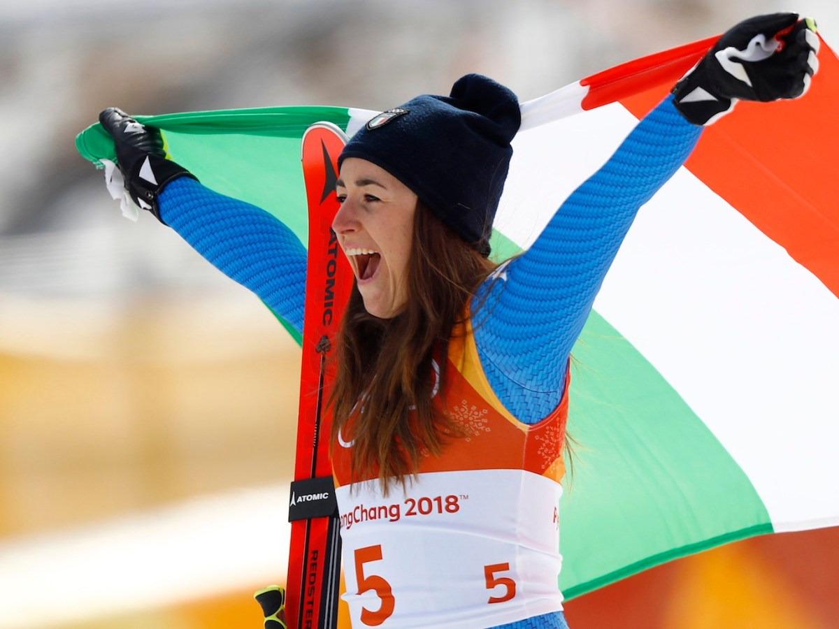 Italy's Sofia Goggia celebrates after winning the women's downhill at the Winter Olympics. Photo: Reuters / Kai Pfaffenbach