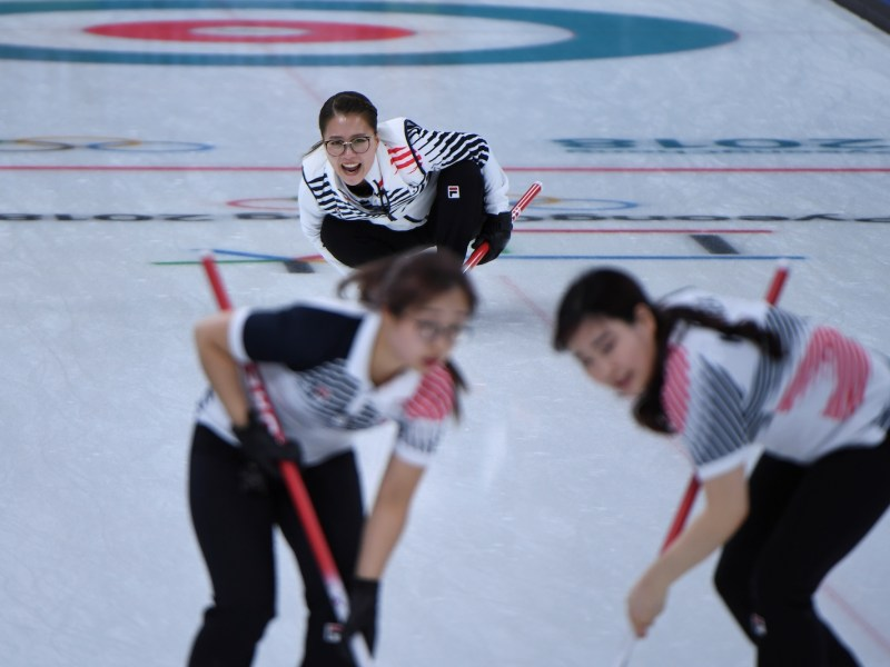 The South Korean women's curling team in action at the Winter Olympics. Photo: AFP / Wang Zhao