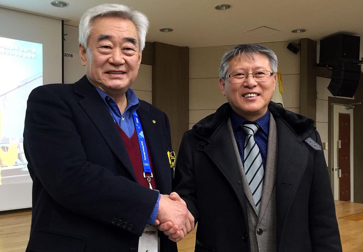 South Korean Chungwon Choue (L), head of World Taekwondo, and North Korean Ri Yong-son, ITF head, in Sokcho on Saturday. Photo: Andrew Salmon/Asia Times