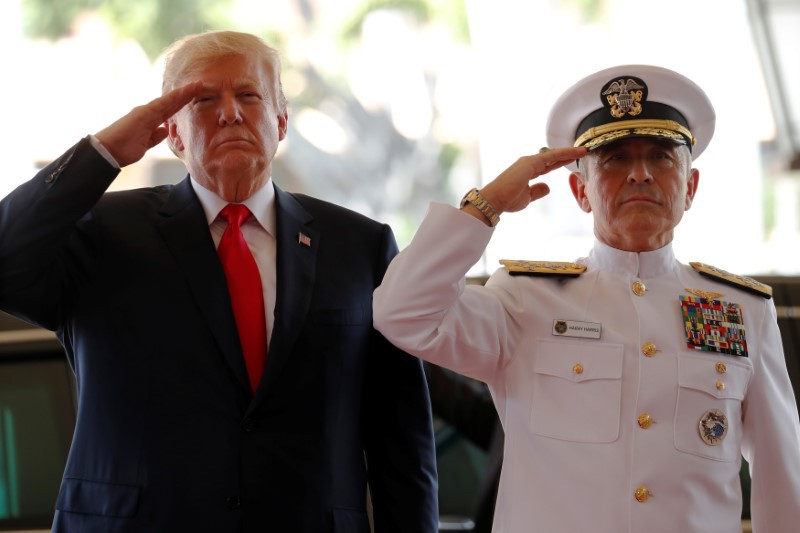 US President Donald Trump is welcomed by US Navy Admiral Harry Harris, then commander of United States Pacific Command, at its headquarters in Aiea, Hawaii, November 3, 2017. Reuters/Jonathan Ernst