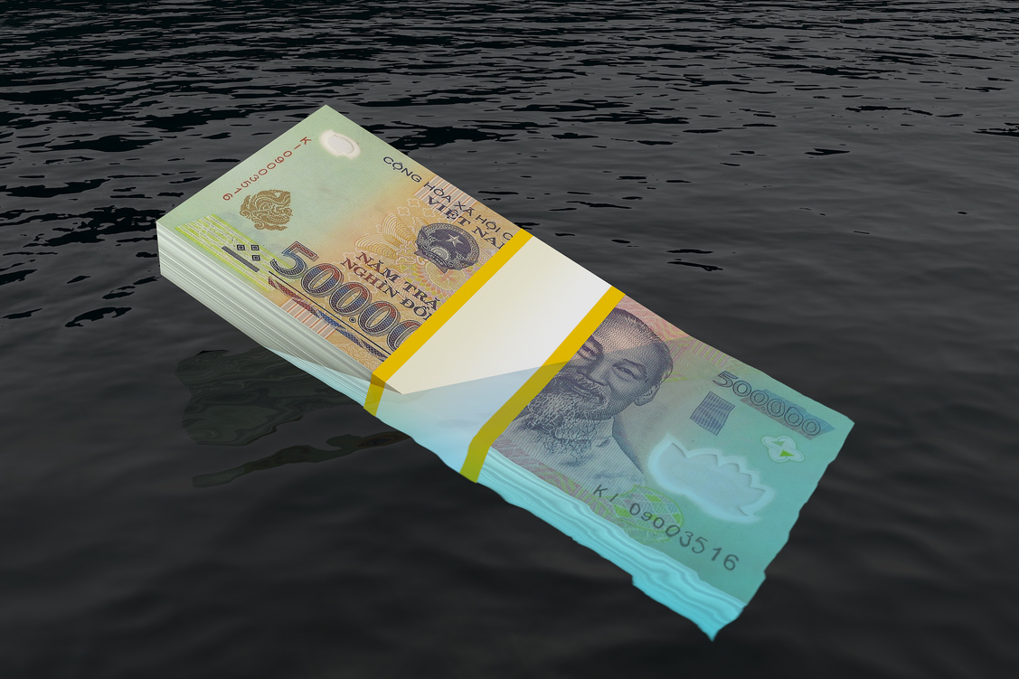 Illustration of Vietnam's dong currency sinking under water. Image: iStock/Getty Images