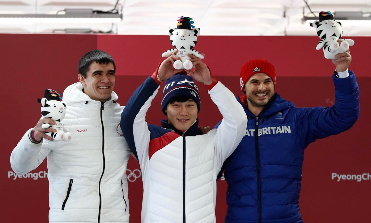 Skeleton Gold medallist Yun Sung-bin of South Korea (C), silver medallist Nikita Tregubov, an Olympic athlete from Russia, and bronze medallist Dom Parsons of Britain enjoy their victory ceremony. Photo: Reuters/Edgar Su